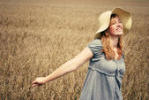 Happy young woman portrait in a fields — Stock Photo