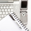 Business laptop and cellphone at the office - Stock Photo