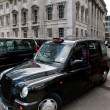 Royalty-Free Stock Photo: Typical traditional british taxi cab in the streets of London
