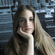 Beautiful young blonde with New York Fund — Stock Photo #7936544