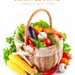Fresh vegetables with green leaves in basket — Stock Photo