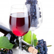 Red wine in glass with grapes — Stock Photo #6784451