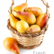 Fresh pear fruits in the basket — Stock Photo