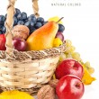 Autumnal fruit in basket — Stock Photo