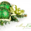 Green balls in snow with branch firtree — Stock Photo
