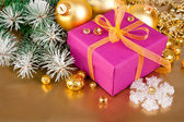 Christmas gift with branch firtree tinsel — Stock Photo