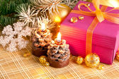 Christmas gift with branch firtree and candle — Stock Photo
