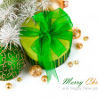 Christmas green gift with firtree branch — Stock Photo
