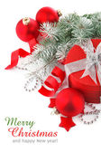 Christmas red gift with branch firtree — Stock Photo
