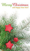 Christmas firtree with red stars and white snow — Stock Photo
