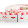 White tape measure with red figures - Stock Photo