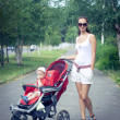Mother with baby in stroller — Stock Photo #7316145