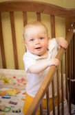 Baby in a cot — Stock Photo