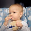 Baby eating bread — Stock Photo