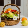 Basket with fruits and flowers — Stock Photo
