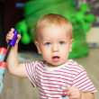 Baby with toy gun — Stock Photo #7641147