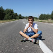 Roller-skater sitting on the road — Stock Photo