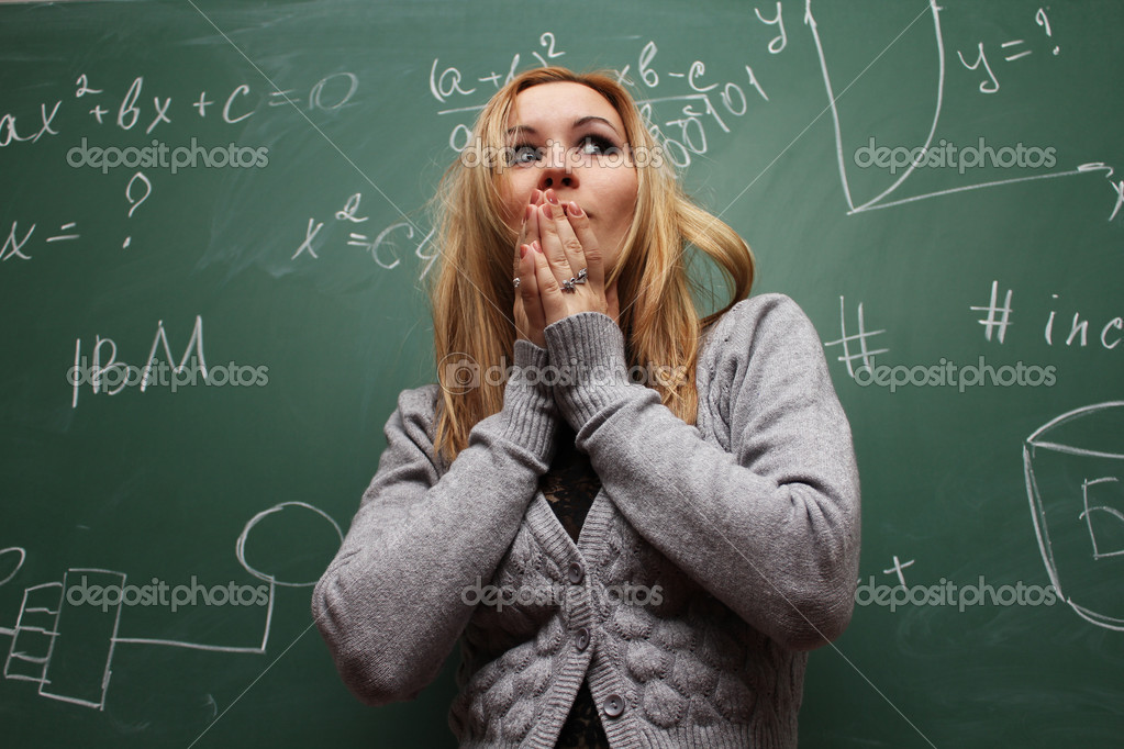 frightened girl near green school board — Stock Photo #7755376