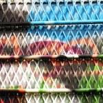 Urban grafitti art on window with cage mesh — Stock Photo #6949946