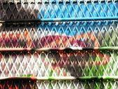 Urban grafitti art on window with cage mesh — Stock Photo