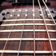 Guitar strings frets and pick ups — Stock Photo #7143918