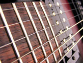 Close up electric guitar frets — Stock Photo