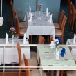 Restaurant tables and tableware - Foto Stock