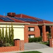 House With Solar Panels On The Roof — Stock Photo #6748508