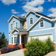 Family house over blue sky — Stock Photo #6873906