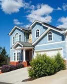 Family house over blue sky — Stock Photo