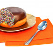 Stock Photo: Chocolate doughnut on golden plate