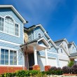 Row of bright new family homes — Stock Photo
