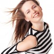 Sexy smiling young woman with streaming hair — Stock Photo
