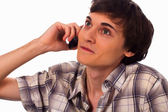 Young man having converstion by phone — Stock Photo