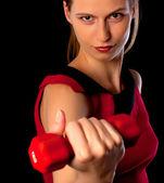 Seriös kvinna idrottsman nen visar hantel — Stockfoto