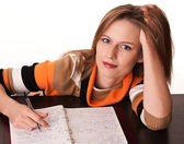 Young tired student on the desk with her notes dreaming — Stock Photo