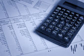 Calculator and financial papers — Stock Photo