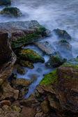 Rocky sea shore at the dusk — Stock Photo