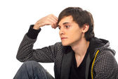 Young man sitting and thinking — Stock Photo