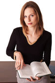 Young woman holding book and looking on camera — Stock Photo