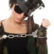 Young woman police officer with handcuffs — Stock Photo