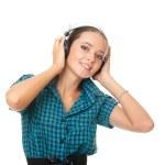 Joyful young woman listening music in big headphones and looking — Stock Photo #6904848