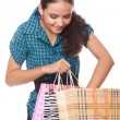 Beautiful young woman looks in the bag for shopping — Stock Photo #6905220
