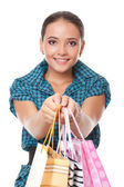 Pretty woman gave bags for shopping — Stock Photo