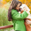 Young mother put little child to him — Stock Photo