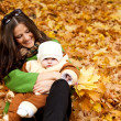 Young mother holding baby in park — Stock Photo #7236684