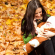Young mother with baby in park — Stock Photo
