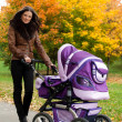 Close-up young mother with stroller — Stock Photo