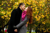 Young loving couple in autumn park — Stock Photo