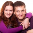 Beautiful young couple embracing — Stock Photo #7555442